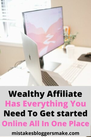 Wealthy-Affiliate-Has-Everything-You-need-to-get-started-online-all-in-one-place-desk-with-laptop-computer-and-desktop-computer-and-keyboard